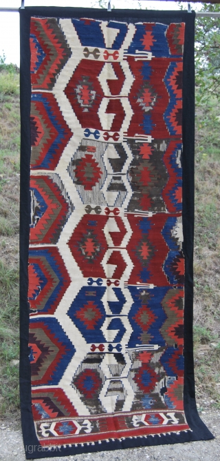 Western Anatolia kilim strip fragment. Cm 100x240 ca. Mounted by Hamid, the best in these works in Istanbul. Archaic, powerful pattern, great, saturated colors, see the aubergine, the kayisi….etc. Could it be  ...