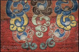 A delightful and very fine Tibetan silk appliqué of Kirrtimukha, or Zpatr. The piece is small and the appliqué elements are likewise very fine. Some areas are embroidered. (see photos) The background  ...