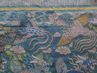 Fragment of a Ming Dynasty silk brocade sutra cover with two phoenixes and two Qilins. Some ink staining in several places. (see photos) 16th century.   14 x 23 inches