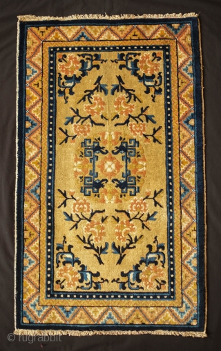 Ningxia Small Rug,Late 19th Century.  Wonderful graphic.  Soft, supple wool.  Elephant head motifs facing each other inside the central medallion.  An elegant small rug.  59 x 95  ...