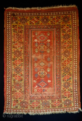 Melas rug, Early 19th Century to 1850.  Great purple and a strong yellow.  Wear in some areas.  Great central field composition.  Kara Memi desgin remnants and the medallions  ...