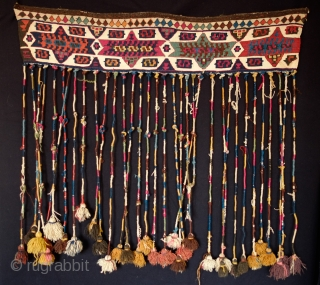 Malatya Kurdish hanging.  Late 19th Century.  Long tassels wrapped in naturally dyed wool ending in beautifully colored tufts.  Great natural colors overall.  It is an unusual piece that  ...