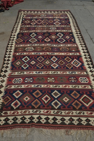 Veramin or Shiraz Kilim, Late 19th Century, great condition and colors. Subtle assymetry in the design with four kochaks in the upper bands and five in the lower bands as well as  ...