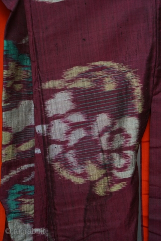 Antique Japanese silk hand-woven ikat kimono, burgundy silk with red and coral silk lining,  in good condition. Circa 1920.