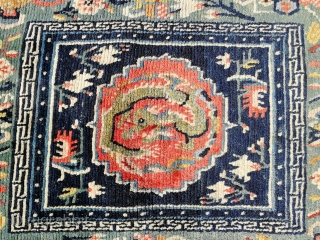 Antique Tibetan sitting/meditation rug.   Fair condition due to age, nice colors and design.
