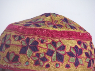 This beautiful hand stitched silk on cotton hat is an early turkmen piece,very fine work and it's a child hat