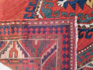 Antique Kazak Lori Pambak  Pile is low with ancient repiling areas. Size is :  237 x 163 cm