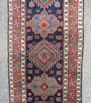 Antique Karadjeh long rug on wool foundations. Dated and signed.   540 cm x 91 cm  Areas of wear  More pics available on request