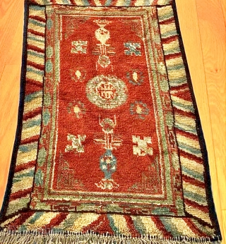 Chinese carpet with Turkestan motifs. Wool on cotton. Minor losses and re-piling in places, sides re-bound. Evidence of fuchsine. Overall full, even pile. Good colour. Affordable. Size: 112cm x 72cm