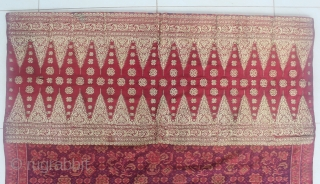 19th Century textile,Limar sarong from Palembang, Indonesia. Size: if the saroong opened will be 200cm x 105cm. Condition: the tumpal (gold thread area) has some damage and has been repaired. the ikat  ...