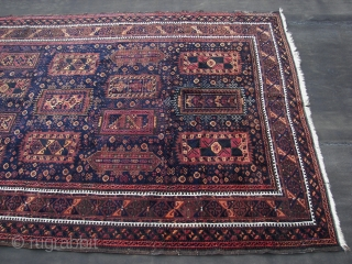 Timuri Baluch ( Khorassan ? ) ca.1900. Wool on wool. ca. 330 cm. x 160 cm. Good overall condition . Great dark blues, madder ,some peach and some yellow highlights. Some oxidation  ...