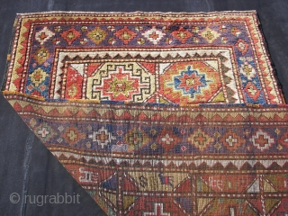 Longhaired Caucasian,with a three row selvage. Moghan ? Kazak ? Wool on wool. Old, ca:1920. ca. 240 cm. x 145 cm. Bird/animal motifs and Memling guls on the inner field. Thick ,lush  ...