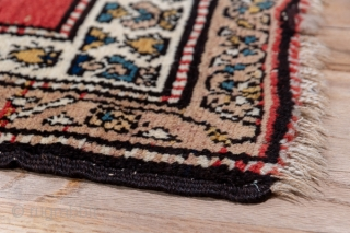 Malayer Runner  3.7 x 14.5 1.12 x 4.41  The brisk red field displays rows of slightly leaning slender floriated botehs, three to a line in a clearly textile-derived pattern. The cream main border of this  ...