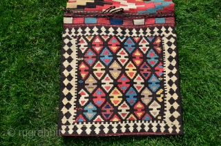 """Shahsavan flat woven (kilim) khorjin with decorated bridge. 1'10"""" x 4'1"""". Circa 1900. Wool. Some faded fuchsin in a few motifs testifies to age. Otherwise all saturated natural dyes. Clean and in  ..."""