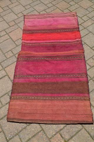 """Large Baluch flat woven khorjin, 2nd. Q. 20th C. 64"""" X 34"""". Wool. Weft substitution designs on face, plain woven striped back. goathair fastening loops and edge wrapping intact. Excellent condition. No  ..."""