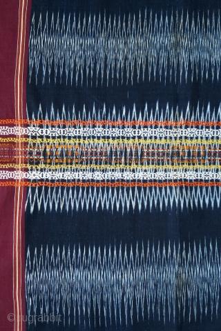 Sumatra   Batak Ikat Shoulder-cloth (Bintang Maratur)  Indonesia, Sumatra, Toba Batak, Silindung Valley; mid 20th C  Commercial cotton, natural and commercial dyes, warp ikat, supplementary warp and weft weaving, twining  A single panel with an  ...