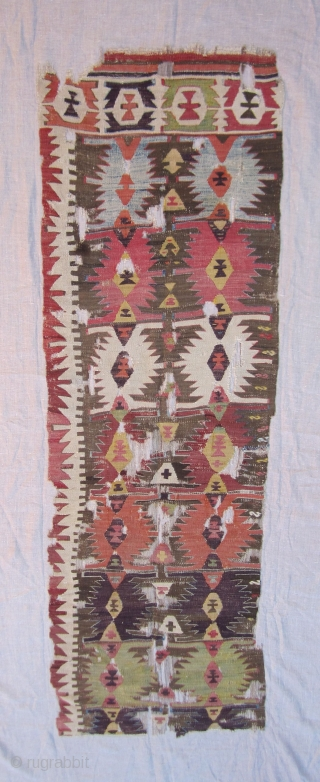 Konya Kilim Fragment......before 1850....approx. 2/3rds of one 1/2....fragment size 2'3 x 7' ( 69 x 213 cm ) with some selvedge.....profess.mounted on linen