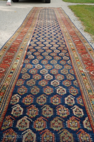 Antique Kurdish or Caucasian runner with boteh pattern. Such great colors and dyes! This is a beauty.  16ft 1in x 40-43in  Good condition. Medium to low pile with one small wear spot in a  ...