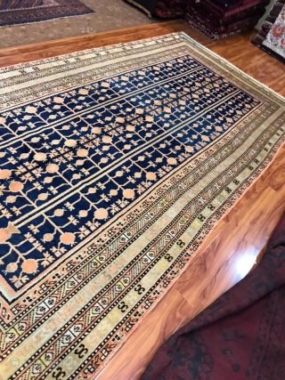 "Antique, circa 1900, Khotan rug with pomegranate field. 6'5"" x 12'8"" or 195 x 385cm. Great condition with only one repair at the end (pictured).