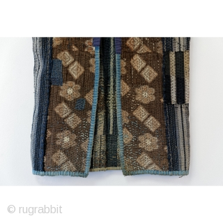 """Sashiko Boro Noragi - Sodenashi with Dense Repairs  Extreme sashiko stitching over this vest.  Rustic antique cottons.  Years of use give this sodenashi a very soft feel.   Suitable for display or wear.   Early 1900's Dimensions: 13""""  ..."""