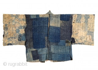 This is one of my favorite pieces in the collection.  A stunning woman's boro noragi - the inside reveals a mesmerizing construction of repairs and reinforcements, held together with hundreds of sashiko stitches.  The  ...