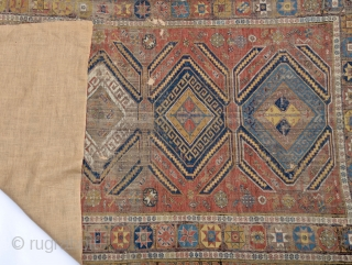 A stunning worn yet elegant Caucasian Soumak flatweave with a linen backing for added support.