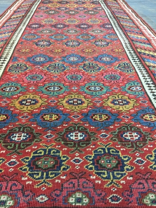 Good Kurdish long rug woven on a wool foundation, Bijar area north west Persia,last quarter 19th ,century,8ft.2in.x4ft.1in.2.49cm.x1.25cm.overall wear with corrosion to Browns,losses to both ends.unusual all over design of rosettes in a  ...