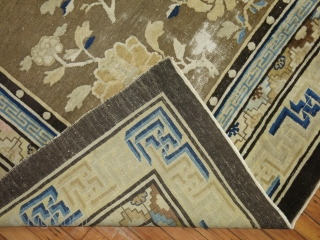 An early 20th century rare original size Chinese square rug in predominant shades of brown. The wool is very soft and all the colors are natural. Some age related wear. untouched
