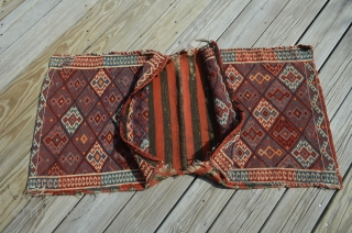 """A beautiful complete pair of early Shahsavan Soumak bags with an unusual border.  Nice color, nice condition.  Measure 23"""" x 23"""" each.  See pictures for a couple of areas  ..."""