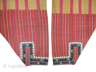 An antique Turkoman / Turkmen silk embroidered silk ikat trousers attributed to the Yomud / Yomut tribe. This beautiful ethnographic bridal textile art dates to the late 19th century and would have  ...