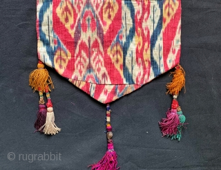 An outstanding Antique mid 19th century Uzbek Adras Ikat shield shaped hanging from Bokhara / Bukhara region. It is a haft rant / seven colour Ikat which is considered the highest form  ...