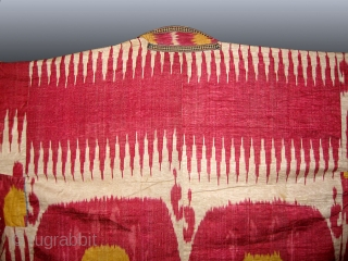 A Fabulous Antique Uzbek Ikat Robe from Bokhara / Bukhara. It is an adras Ikat (silk warp/cotton weft) from late 19th Century. The gorgeous design of two large medallion surrounded by zig  ...