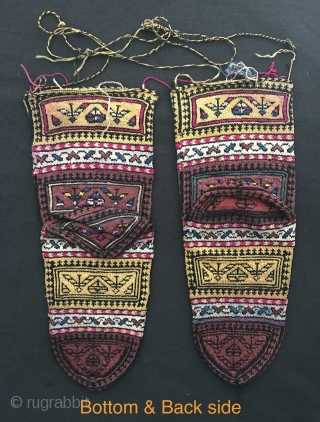A very rare and museum grade antique Persian Qajar dynasty ceremonial silk knitted socks. Dating to approximately late 19th century, these ethnographic textiles are quite rare things and served a ceremonial purpose.  ...