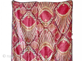 An outstanding and rare antique Uzbek silk adras Ikat hanging from Bukhara / Bokhara, dating to the mid 19th century. This very early example is a silk warp and cotton weft Ikat  ...