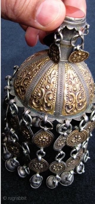 An extraordinary silver with gold appliqué with carnelian inset antique Turkoman / Turkmen Jewellery attributed to the Yomud / Yomud confederation tribes. Dating to the 19th century, this is a coveted example  ...