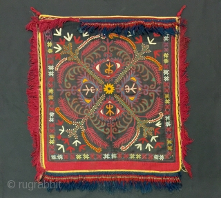 a very Elegant antique Kirghiz silk suzani embroidered squared wall hanging, dating to the late 19th century. The classic and very archaic design is drawn using fine silk embroidered with a masters  ...