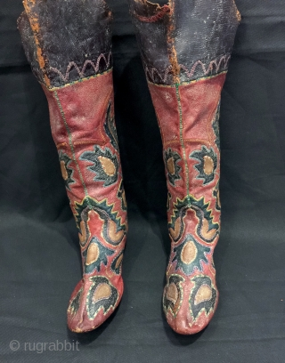 An exceptional antique Central Asian leather appliqué boots dating to the second half of the 19th century. This particular is relatively older than most one sees in the market and many of  ...