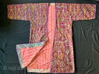 An excellent Antique Central Asian Adras Ikat Chapan / Robe made by the Tajik people of Ferghana Valley / Kokand region. It dates to the early third quarter of 19th century.   ...