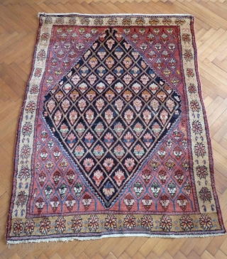 An unusual Northwest Persian rug, early 20th Century. Flower filled lattice design. Repair at one end, otherwise great condition. All good colours and very soft wool. 190 x 137 cm
