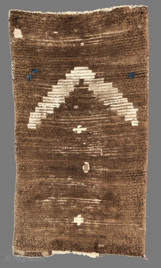 Primitive, old, minimal Turkish prayer rug. Central Anatolia.  19th century. Fully lined with a museum grade linen backing and velcro hanging strip. Size: 50 x 27.5 inches.  The images here  ...