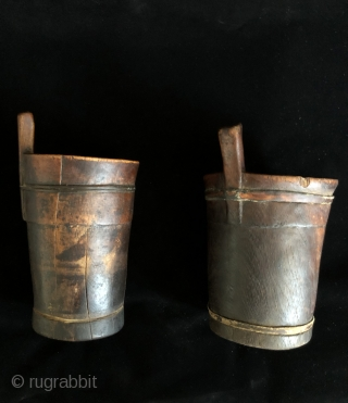 Two ancient Wooden Drinking vessels (kero) from the altiplano region of Bolivia.  Ritual drinking and feasting was a vital part of Andean culture and was the glue that fostered and cemented  ...