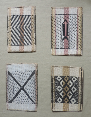 Mbole Losa mats, (small clan emblems) Congo, Zaire, 20th century. Four pieces approx. 14 x 20 inches each.