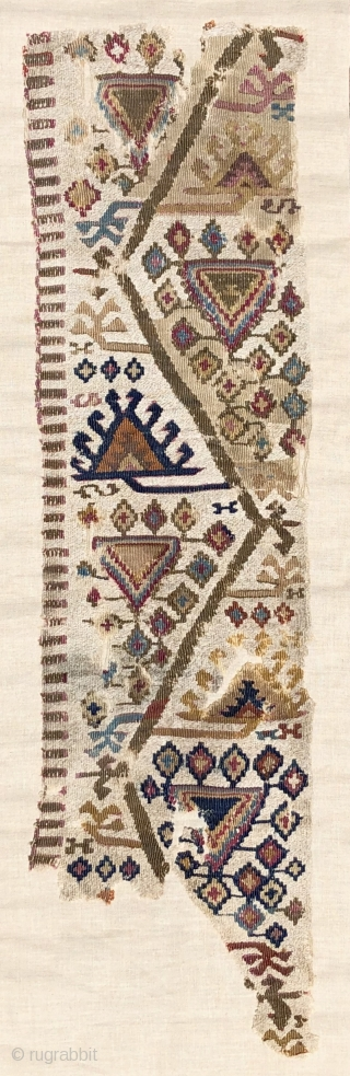 Antique Reyhanli kilim fragment.  Unusual two tone - mixed wool and cotton wefts used as an off-white field or ground color.  There is an animated, almost musical quality to the  ...