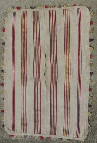 A unique, white ground Aymara Ponchito (small poncho). Altiplano region, Bolivia. Early 19th Century or before. One of a kind cotton and alpaca man's ceremonial overgarment. The only ponchito of the type  ...