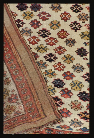 Serab Carpet.  19th century.  White ground with floating gul shapes and a camel hair border.  Size: 108 x 55 inches.