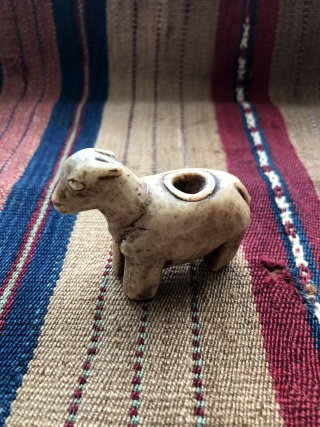 Carved stone fetish figures from Bolivia.  This animal figure with an opening on its top is called a canopa. Although they are a well known from the Inca period, this 19th  ...