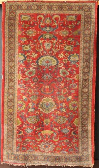 "Sultanabad rug ca 1900, 3'3"" x 5'8""."