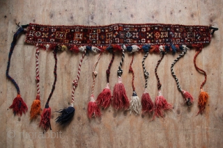 """Interesting Qashqai animal trapping, first half of the 20th century. Quite an unusual and decorative object, attractive with the tassles. Size includes to tips of tassles: 117 x 56cm / 3'10"""" x  ..."""