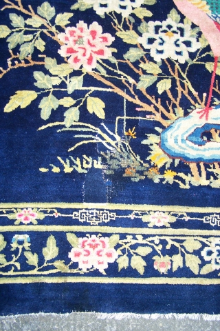 Chinese Carpet, (main image is from the back) early 20th.century, has some synthetic colours and (I count) five patch repairs, otherwise pile in reasonable condition, replaced side selvages, 180 x 276cm