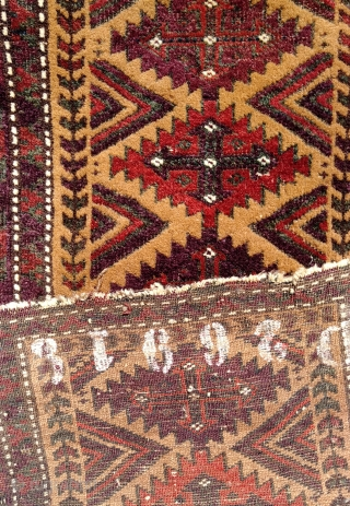 Antique camel field balisht with richly saturated aubergine, madder and emerald green which in places has oxidized. Wear at the margins and a split have not marred the impact of the wool  ...